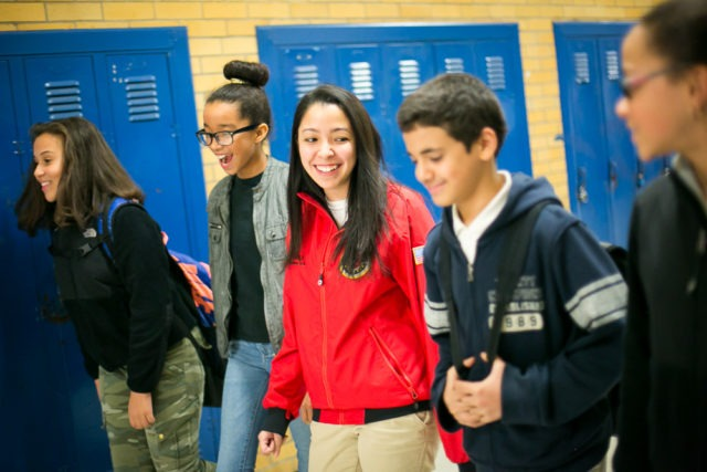 City Year AmeriCorps member in school with students