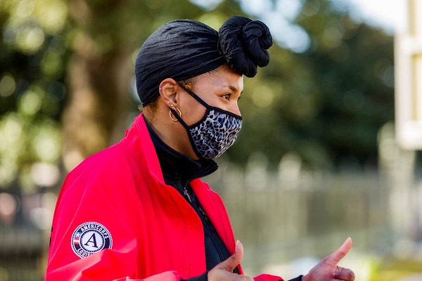 City Year AmeriCorps member wearing mask supporting students