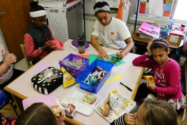 City Year AmeriCorps member works with students