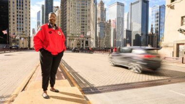 City Year AmeriCorps member on busy city street