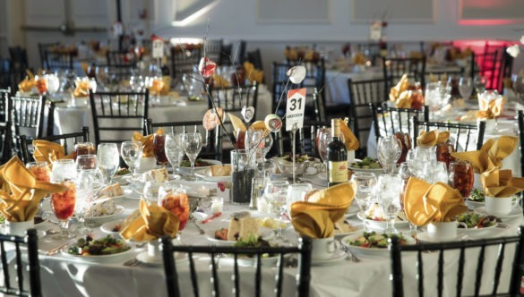 A table is set for a formal City Year event