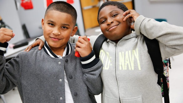 Two elementary students pose for the camera
