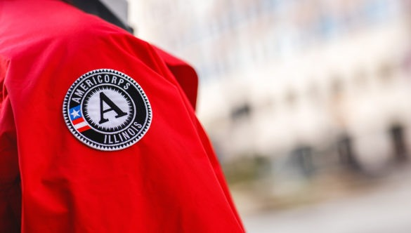 A close up of the AmeriCorps logo patch on the City Year jacket.