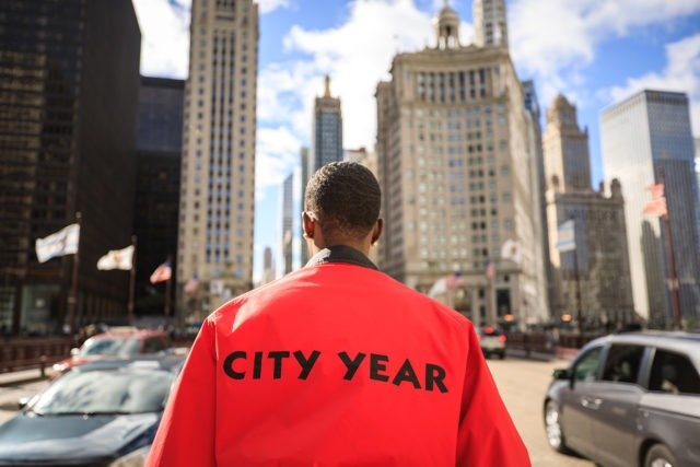 An AmeriCorps member looks ahead at the city skyline.