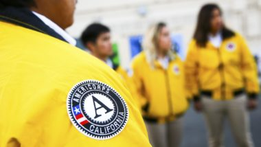 Close up of the AmeriCorps California patch on a yellow City Year jacket