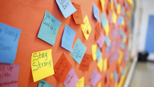 Bulletin board with inspirational and positive notes.
