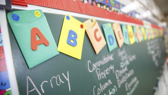 Alphabet signs displayed in the classroom.