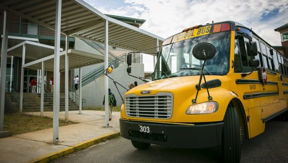 A school bus parked outside of school.