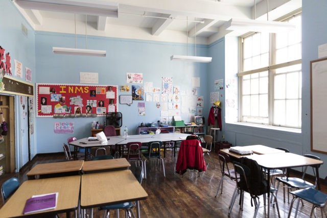 A classroom with desks in small groups.