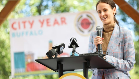 A woman speaks behind a podium at City Year event