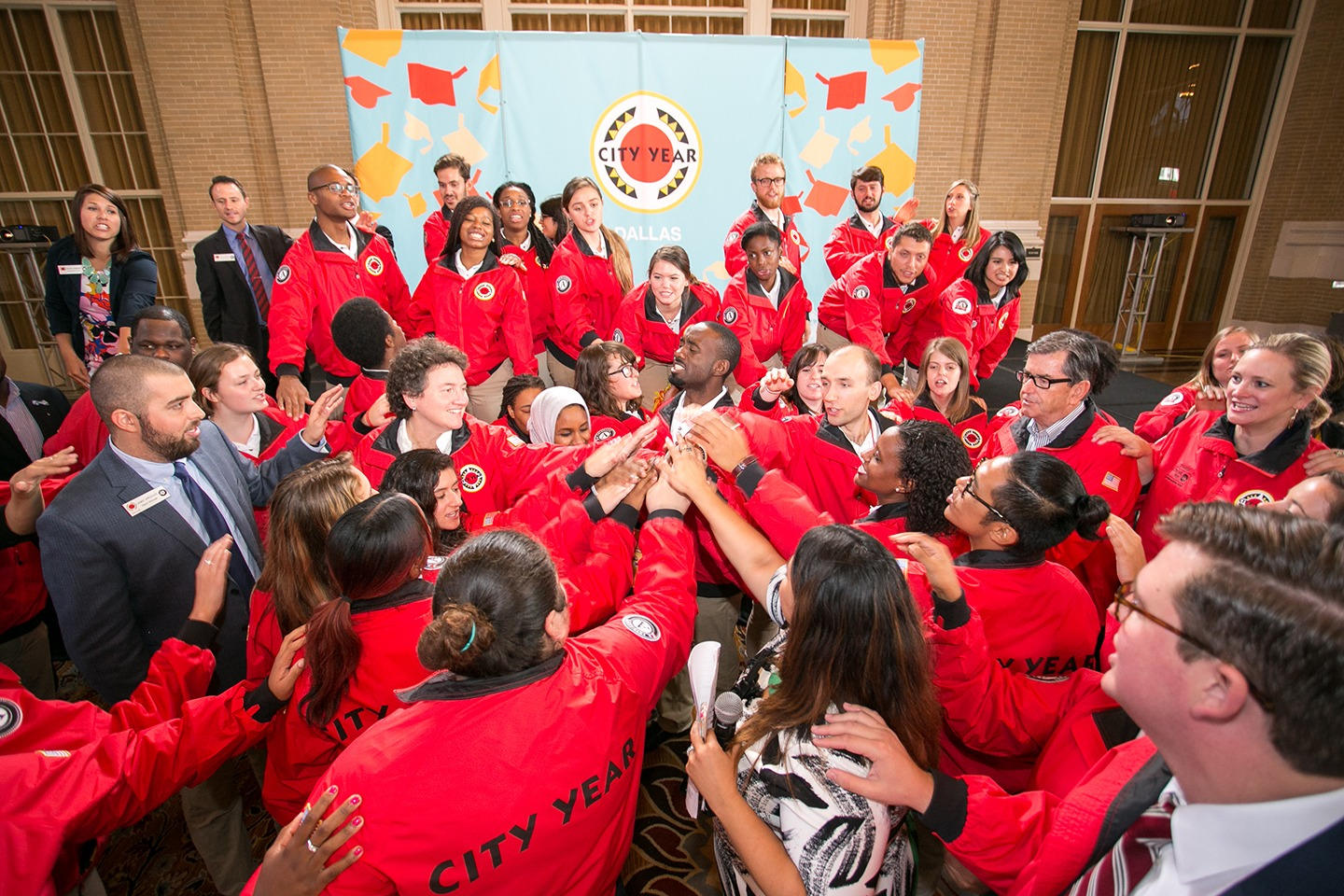 A group of City Year AmeriCorps members and staff doing a spirit break