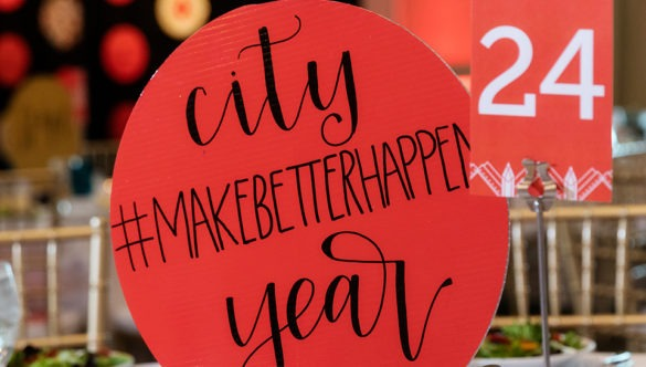 A centerpiece reads Make Better Happen at a formal City Year event