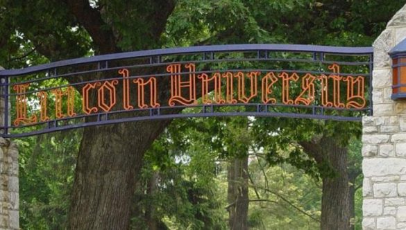 "Decorative arch with sign reading ""Lincoln University."""