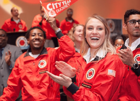 City Year AmeriCorps members cheering at their opening day
