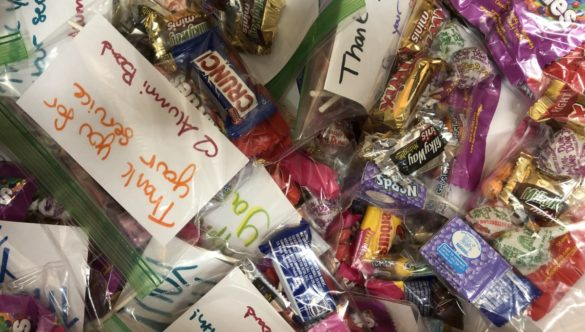 Small bags of cansy with hand-written notes of appreciation