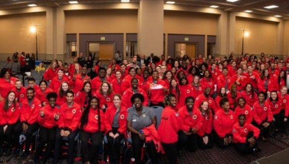 City Year Philadelphia's entire team of AmeriCorps smile at the camera.