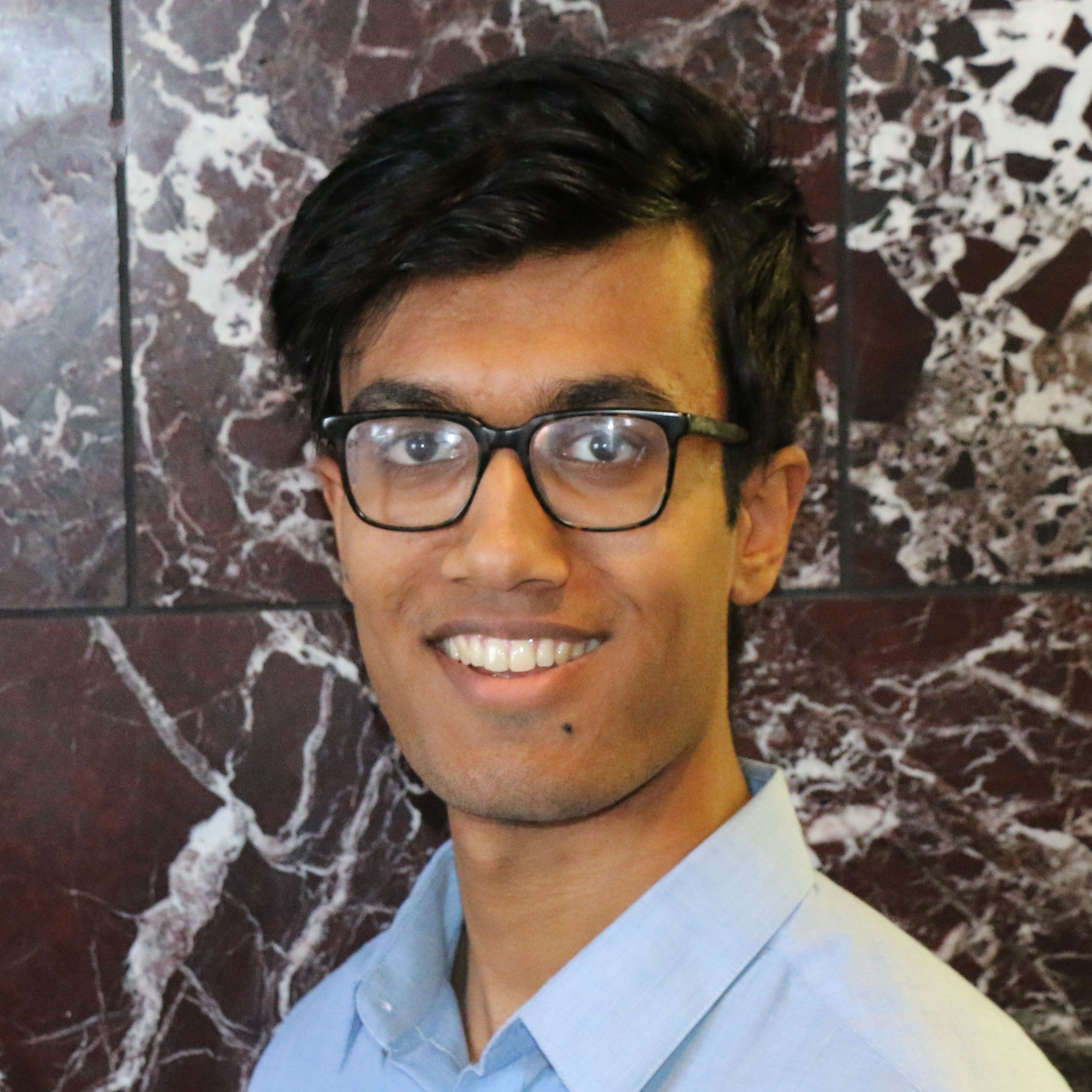 Headshot of staff member, Sam Soundarajan