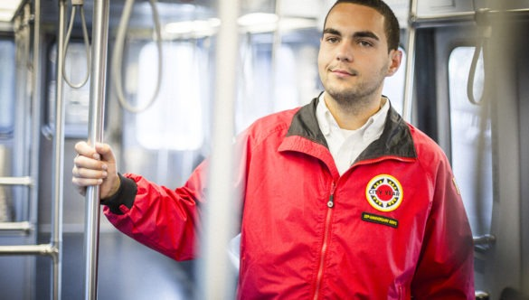 An AmeriCorps member rides the subway.