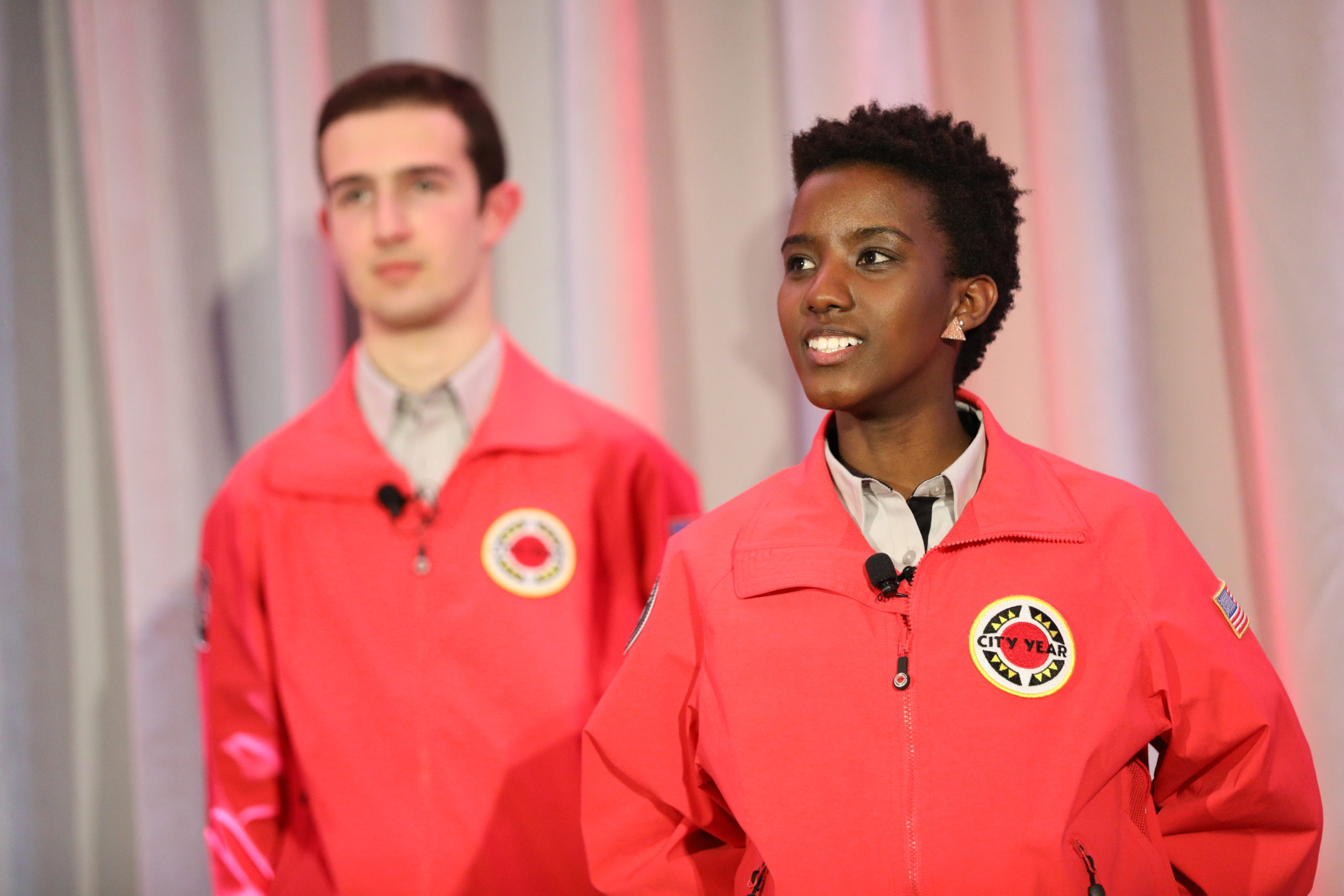 AmeriCorps members proudly present their service to the audience.