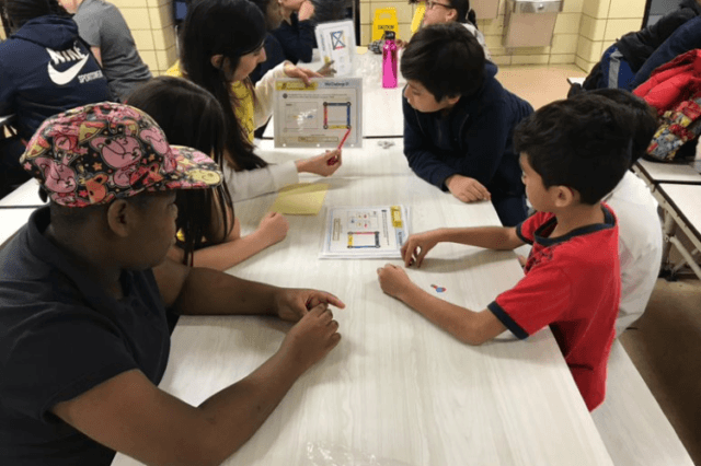 City Year AmeriCorps members work with students in STEM