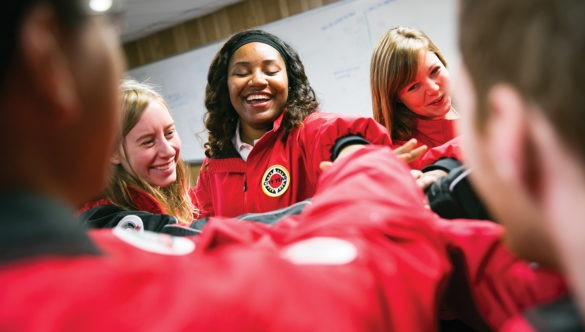 americorps members place their hands in a spirit break