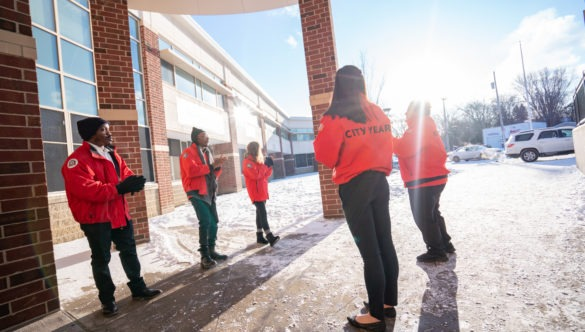 City Year AmeriCorps members welcome students