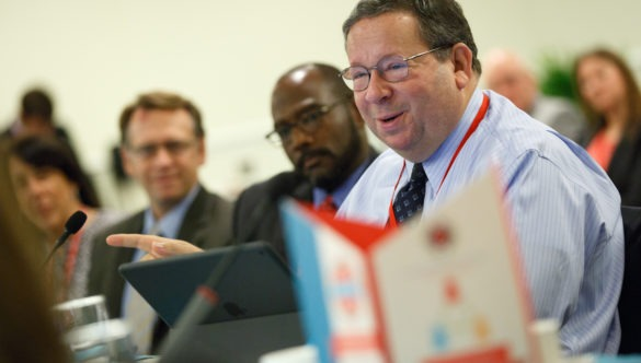 David L. Chohen speaks in a meeting at the City Year Investor's Summit