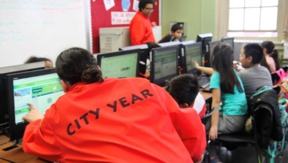 City Year AmeriCorps members facilitate Hour of Code for students