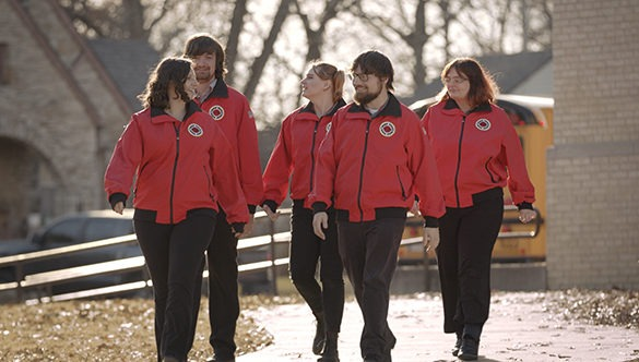 Five City Year AmeriCorp members chatting as they walk outside