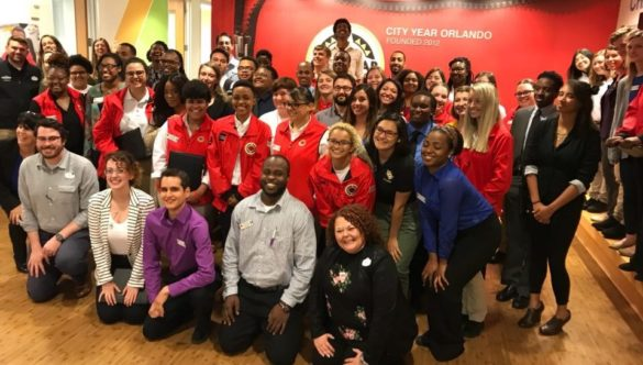 members of the Universal Orlando Resort Human Resources take a group picture with the Orlando corps