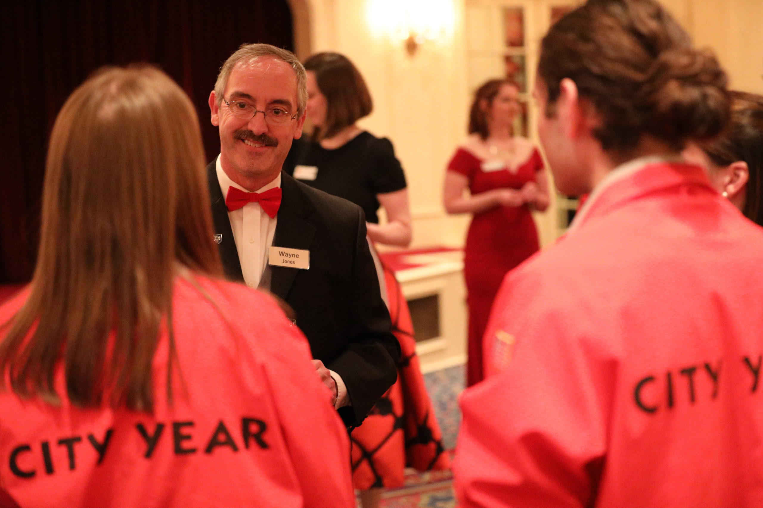 AmeriCorps members mingle with guests