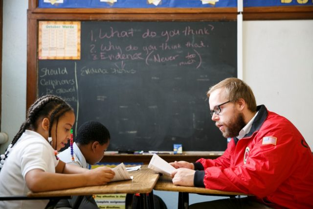City Year AmeriCorps member tutoring students