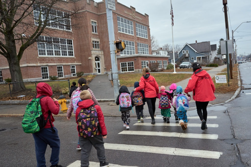 Walking bus City Years and students approach Bakersville School