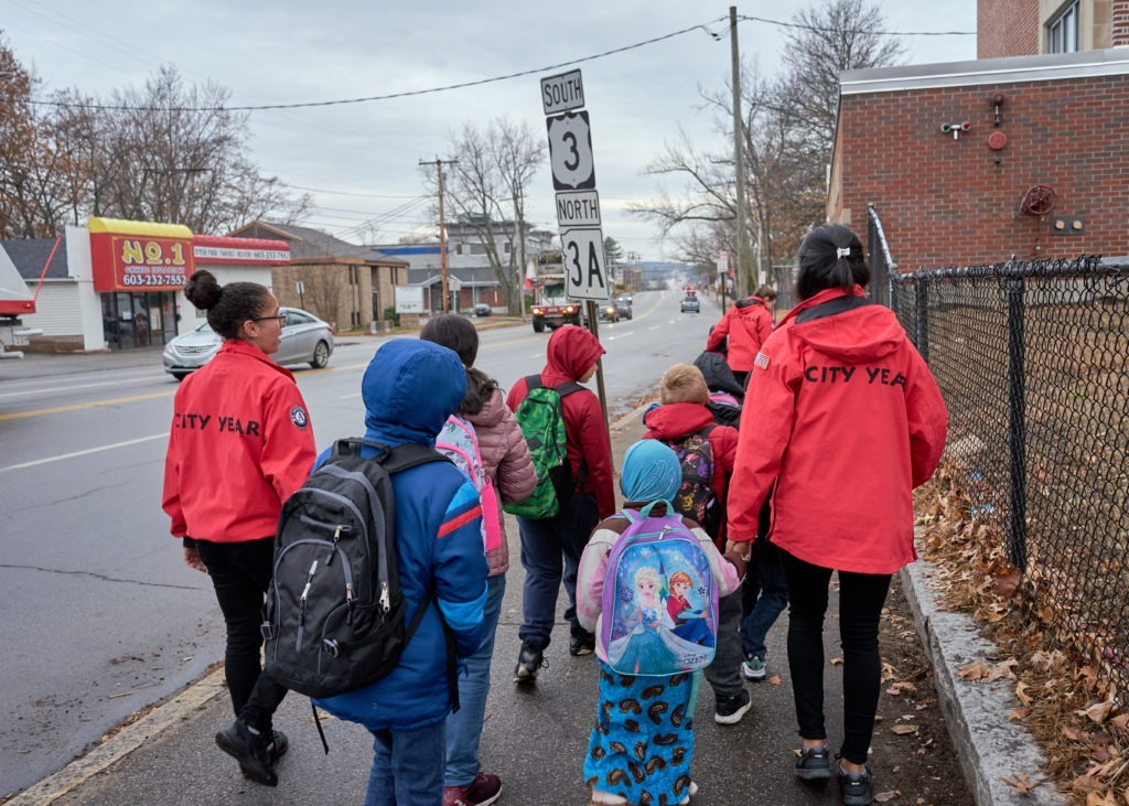 Students are guided to school by City Years on the walking bus