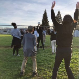 A City Year americorps member plays volleyball with students