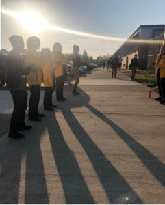 City Year AmeriCorps members powergreet students into school