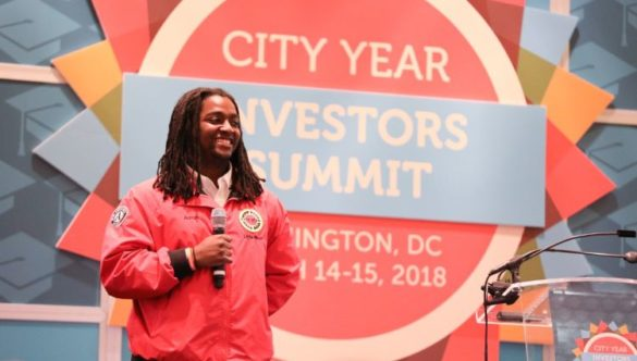 City Year AmeriCorps member speaking at event