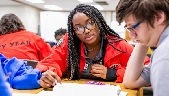 City Year AmeriCorps member in school service