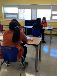 City Year AmeriCorps members working one-on-one with students