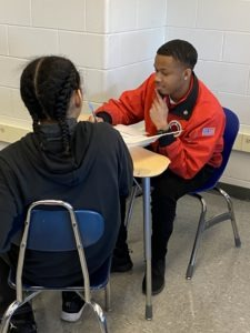 City Year AmeriCorps member working one-on-one with student.