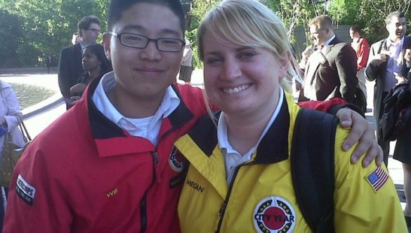 Two City Year AmeriCorps members red jacket yellow jacket
