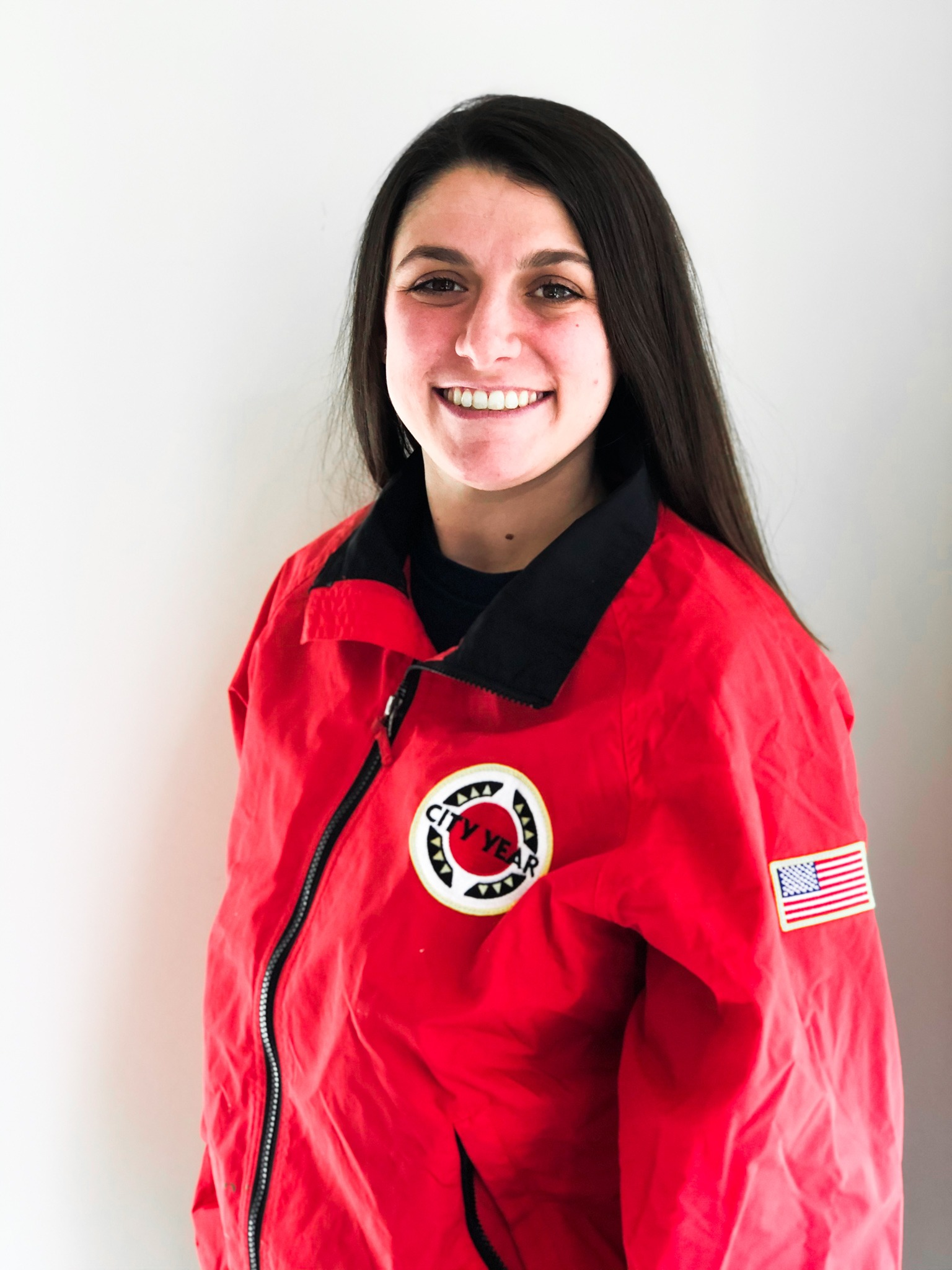 Danean Balestrieri in a CY red jacket