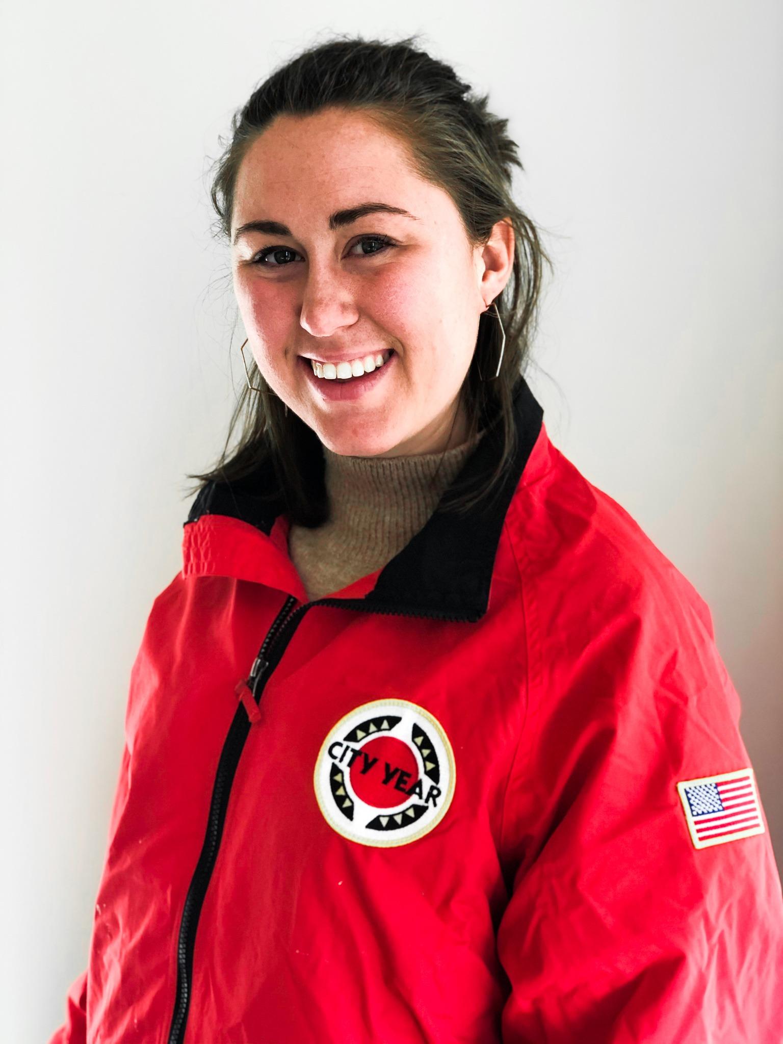 Ellie Carver in a CY red jacket