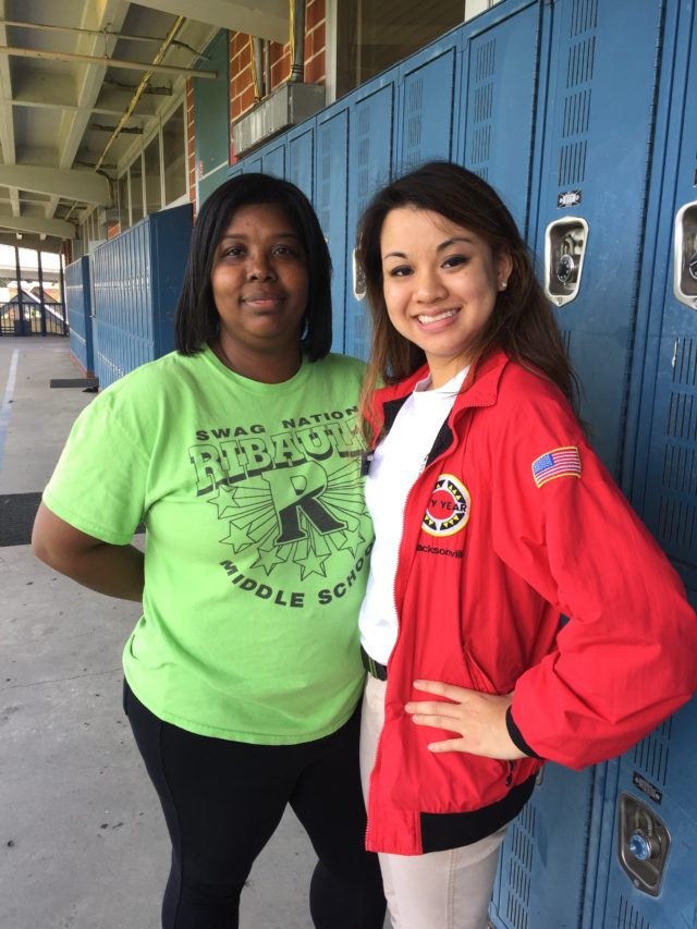 City Year Alum, Emily Wasek, poses with her partner teacher at a Duval County Public School.