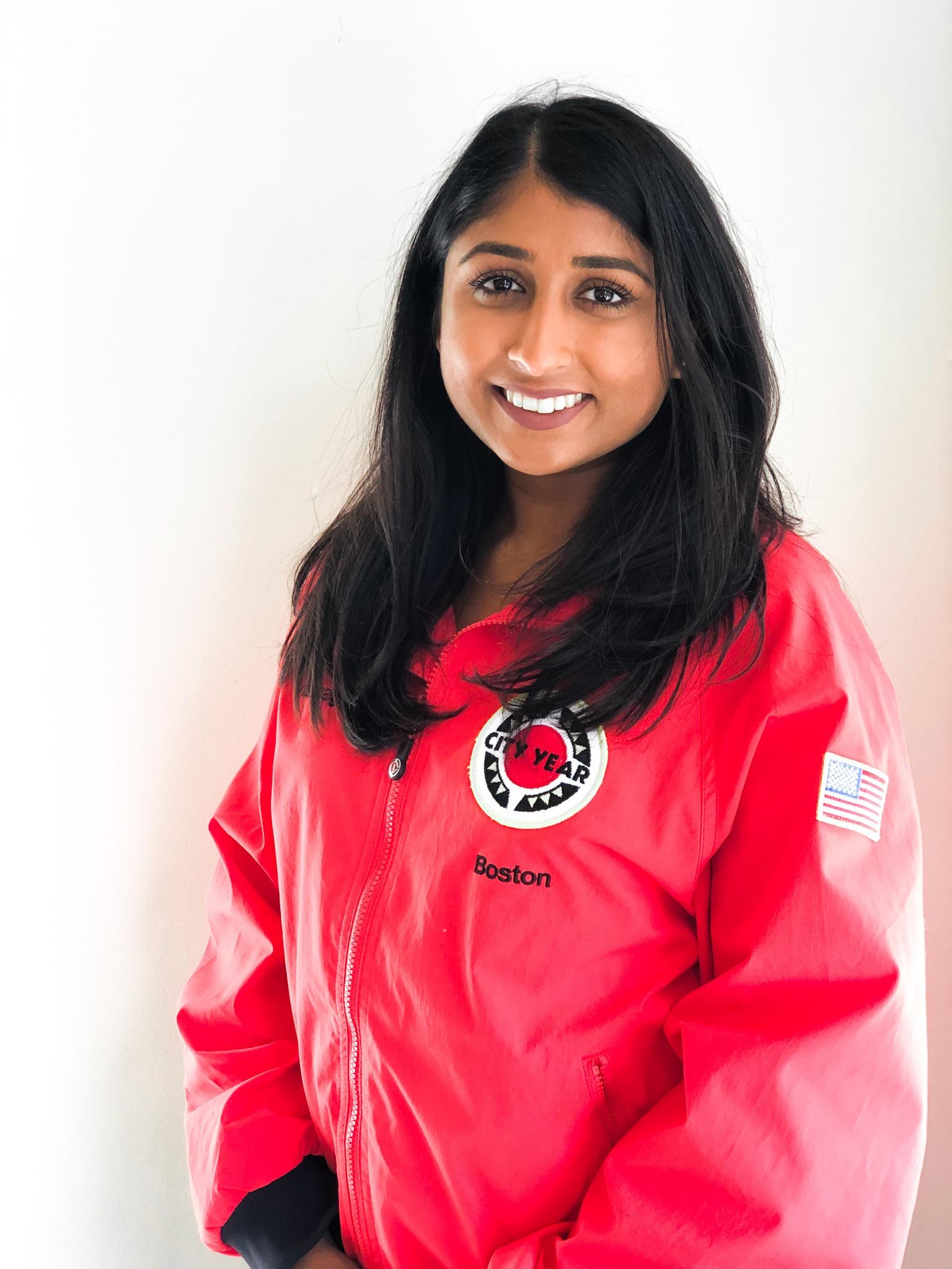Kalpita Patel in a CY red jacket