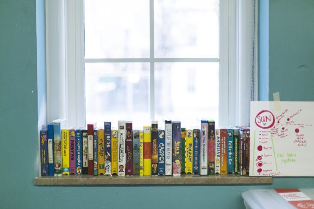Books on a bookshelf in a City Year school