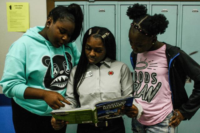 City Year Milwaukee AmeriCorps member tutoring students