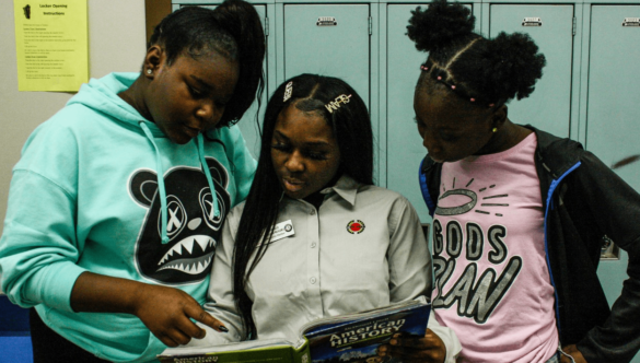 City Year Milwaukee AmeriCorps member tutoring students