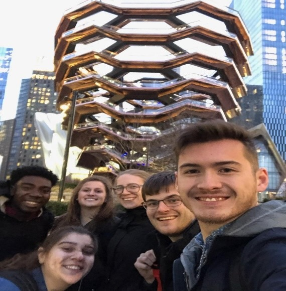 Team Care Force poses in front of The Vessel at Hudson Yards in New York.
