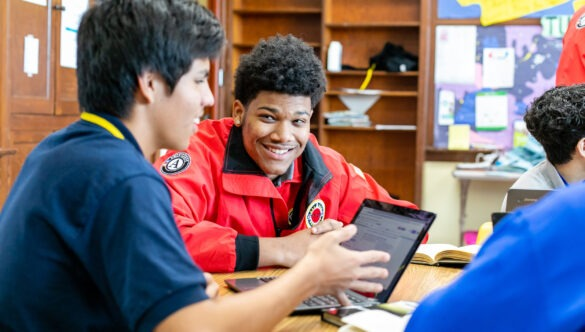 City Year AmeriCorps member tutors and mentors students